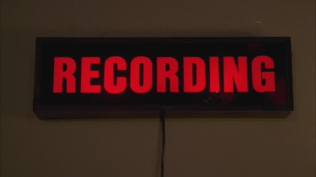 CU Illuminated recording sign in studio