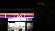 Illuminated signage for Circle K is displayed outside convenience store operated by Circle K Sunkus Co a subsidiary of Uny Group Holdings Co at night...