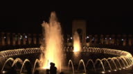 MS, Illuminated World War II Memorial fountain at night, Washington DC, Washington, USA,