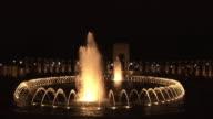 MS, Illuminated World War II Memorial fountain at night, Washington DC, Washington, USA,