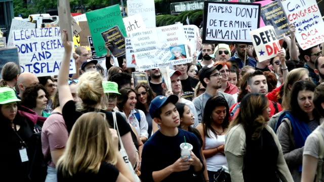 Immigration advocates and supporters rallied in Columbus Circle 59th Street in front the Trump International Hotel and Tower in Manhattan to protest...