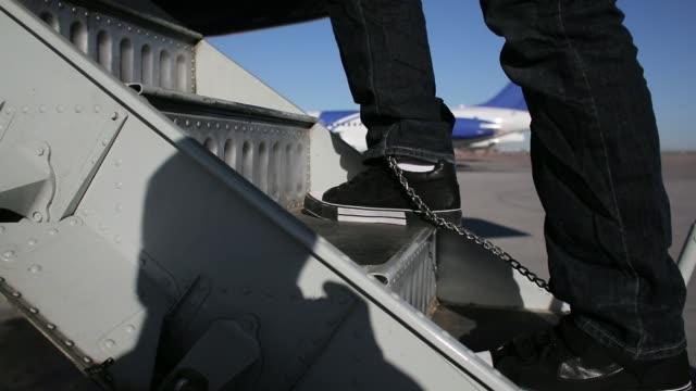 Immigration detainees board deportation flight Immigration detainees board deportation flight on February 28 2013 in Mesa Arizona