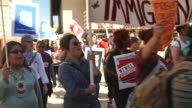 Immigration protest at the Arizona State Capitol Video includes shots of signs reading 'Boycott Racism' a Donald Trump piñata and SOT with a young...