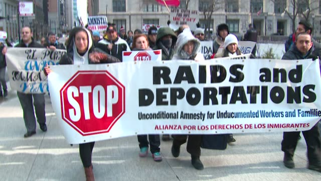 WGN Immigration rights activists rallied in the Daley Plaza and marched through the Loop in Chicago on January 23 2016