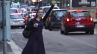 MS, SELECTIVE FOS, Impatient woman on busy city street hailing cab, Sydney, Australia, SELECTIVE FOCUS