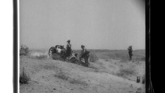 Imperial Japanese Army soldiers use pack howitzers and infantry weapons as they defeat British Commonwealth troops and capture the oil fields in the...