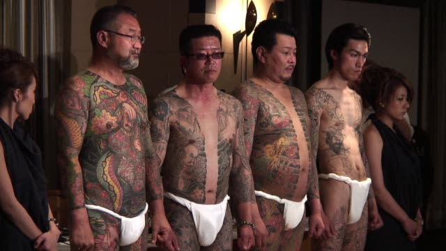 In a country where tattoos are often associated with gangsters and banned in many public places one of the masters of this traditional art is...