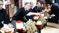 In a February 17 Japan ceremony meant to call for a bountiful and healthy year 32 men dressed in traditional formal attire gathered in a house in...