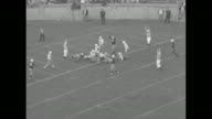 In action on field in Yale Bowl Yale Bulldogs complete pass / Yale completes pass to less than yard from goal line / Yale runs quarterback sneak for...