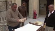 In an empty room in Syrias National Museum of Damascus employees carefully wrap the last few statues and place them in boxes to be transported to a...