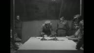 In British HQ tent at Luneburg Heath German Rear Adm Gerhard Wagner signs instrument of surrender of all German forces in Holland NW Germany and...