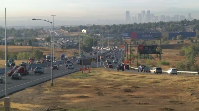 I25 in Denver is usually congested and the view from Thornton Parkway in the morning whows the smoggy downtown skyline