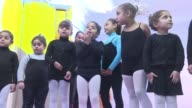 In Egypt's conservative southern province of Minya young girls in black leotards and white tights wobble on their tip toes to classical music in a...