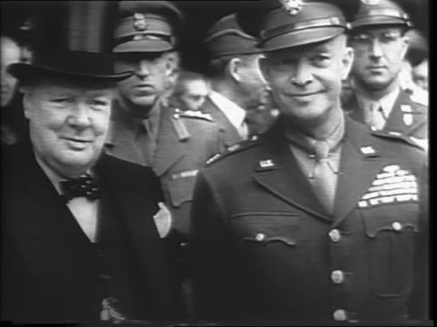 In England General Dwight D Eisenhower and British Air Chief Marshal Arthur William Tedder get into carriage / Eisenhower riding past crowds in...