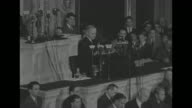 In his first speech as US president Harry S Truman speaks at rostrum in the House of Representatives chamber Speaker of the House Sam Rayburn and...