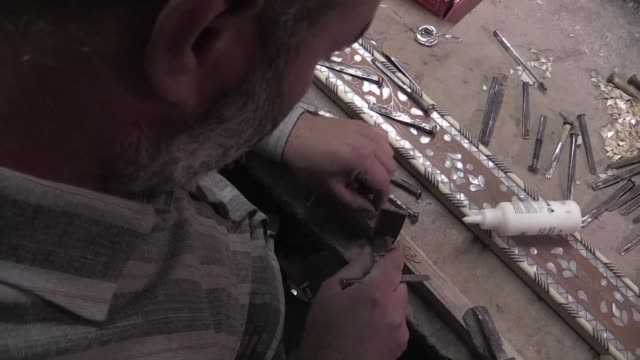 In his workshop in the Syrian capital Damascus Mohammad Abdallah says he fears his craft the intricate process of filling carved wooden decorative...