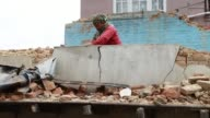 In Khokana Napal residents are cleaning up after Tuesday's earthquake and powerful aftershocks
