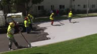 In Los Angeles where summer temperatures regularly surpass 100 degrees Fahrenheit workers are coating streets in special gray treatments in a bid to...