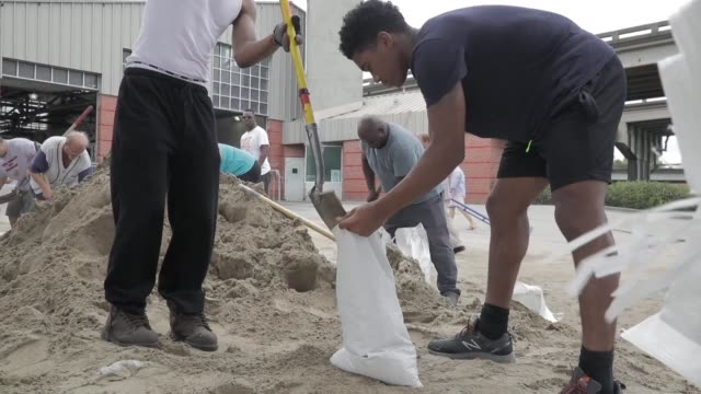 In Louisiana's flood prone city of New Orleans residents were out early Saturday to fill sandbags and complete preparations ahead of Hurricane Nate...