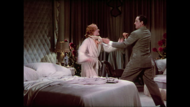 In love, man (Fredric March) bullies woman (Carole Lombard) into action