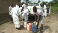 In Sierra Leone specialized Ebola inhumation teams go around villages to safely bury people dead from the Ebola virus