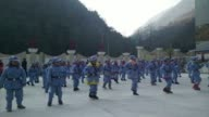 In sky blue army uniforms emblazoned with red stars they could be Communist comrades from Chinas civil war