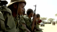 in the back of a pickup truck leaving Somali militia men on July 31 2011 in Dhoobley Somalia