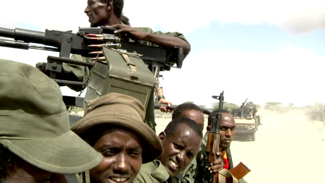 in the back of a pickup truck riding in convoy Somali militia men on July 31 2011 in Dhoobley Somalia