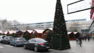 In the foreground is an installation with the inscription 'Christmas Market City' in the background fir trees and the memory church where the...