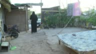 In the Haret al Tanak region a poor neighbourhood in Lebanons northern port city of Tripoli Syrian refugees carry on Ramadan despite life in their...