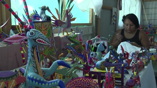In the Mexican region of Oaxaca talented craftsmen make colourful wooden figures called alebrijes an occupation that supports almost entirely the...