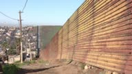 In the poor Mexican neighborhood of Tijuana that lines the US border fence residents fear that the construction of the wall will expel them from...