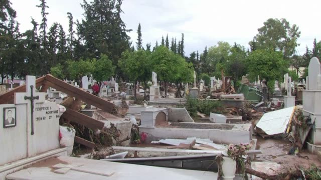 In the small town of Mandra the cemetery has been totally destroyed by the flash flood that hit Greece on Friday