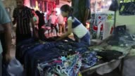 In the Syrian city of Azaz residents buy clothes and food to celebrate Eid al Fitr at the end of the holy month of Ramadan