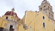 In the town of Atlixco where the Our Lady of the Nativity church was damaged by the powerful earthquake that struck Mexico one day ago exchange...