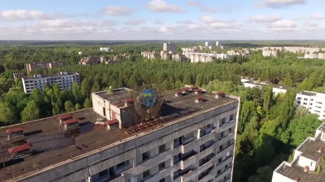In this aerial view a Sovietera hammer and sickle are adorned with a Ukrainian flag on top of an abandoned apartment building on September 30 2015 in...