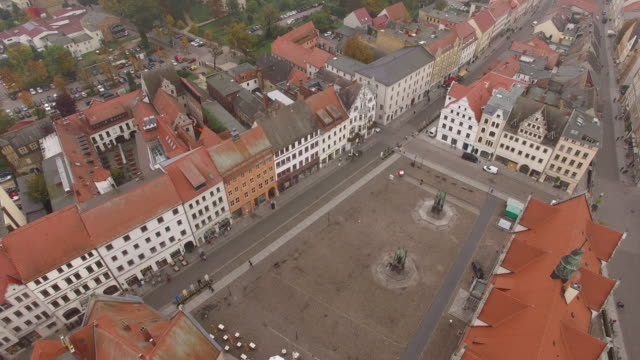 In this aerial view the Stadtkirche Sankt Marien church where theologian Martin Luther preached and held the first vernacular mass stands in the...