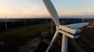 In this aerial view wind turbines spin at a windpark near the Jaenschwalde coalfired power plant on land recovered from a former openpit coal mine on...