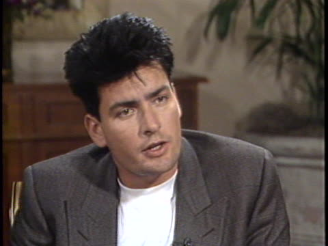 In this interview actor Charlie Sheen talks about his role in Young Guns Sheen talks about working with his brother and what types of roles he...