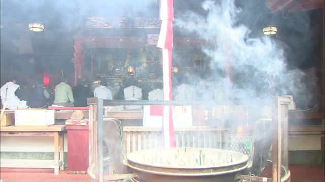 Incense burns as pilgrims pray inside temple that forms part of 'New 88 Temples of Sasaguri' route