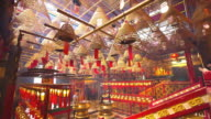 Incense coils burning at Man Mo Temple, Hong Kong, Pan up