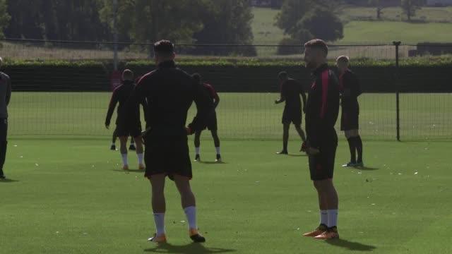 Includes shots of Arsene Wenger Steve Bould Jens Lehmann Jack Wilshere Sead Kolasinac Alex Iwobi Per Mertesacker theo Walcott Olivier Giroud Matthieu...