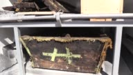 Incorrupt corpse of an intruder Russian army officer whose military clothing is still on is seen in a coffin after it was discovered during an...