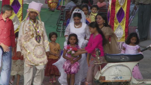 India wedding party walking through street