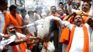 Indian activists from the right wing Hindu nationalist group Shiv Sena burn an effigy of Jamaat ud Dawah chief Hafiz Saeed following an attack on...