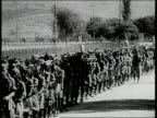 Indian Army and Navy troops marching / India