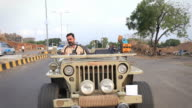 Indian man Driving an Open Vintage Jeep