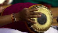 Indian Person playing a Dholak