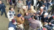 Indian riot police armed with batons beat back dozens of supporters of Delhi's Chief Minister Arvind Kejriwal on Tuesday to prevent them from joining...