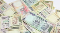 Indian Rupee currency bills banknote falling